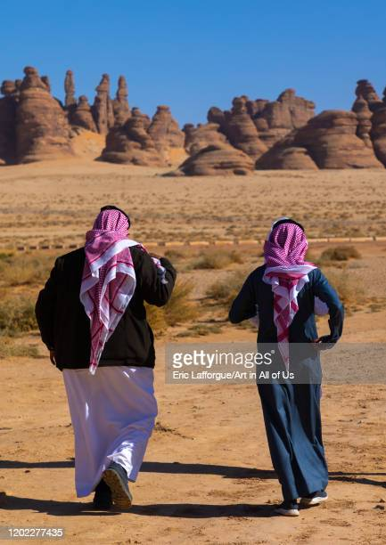Rear view of saudi men in Madain Saleh, Al Madinah Province, Alula, Saudi Arabia on December 28, 2019 in Alula, Saudi Arabia.