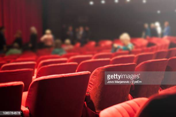 rear view of seats in movie theatre - zuschauerraum stock-fotos und bilder