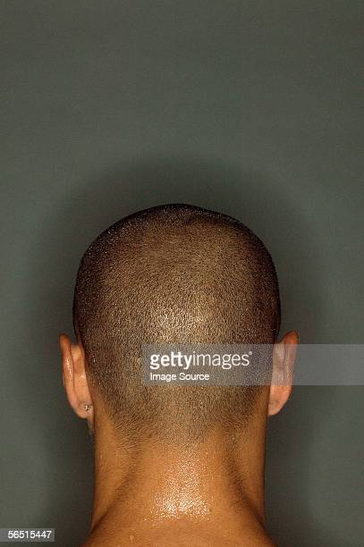 Rear view of shaved head