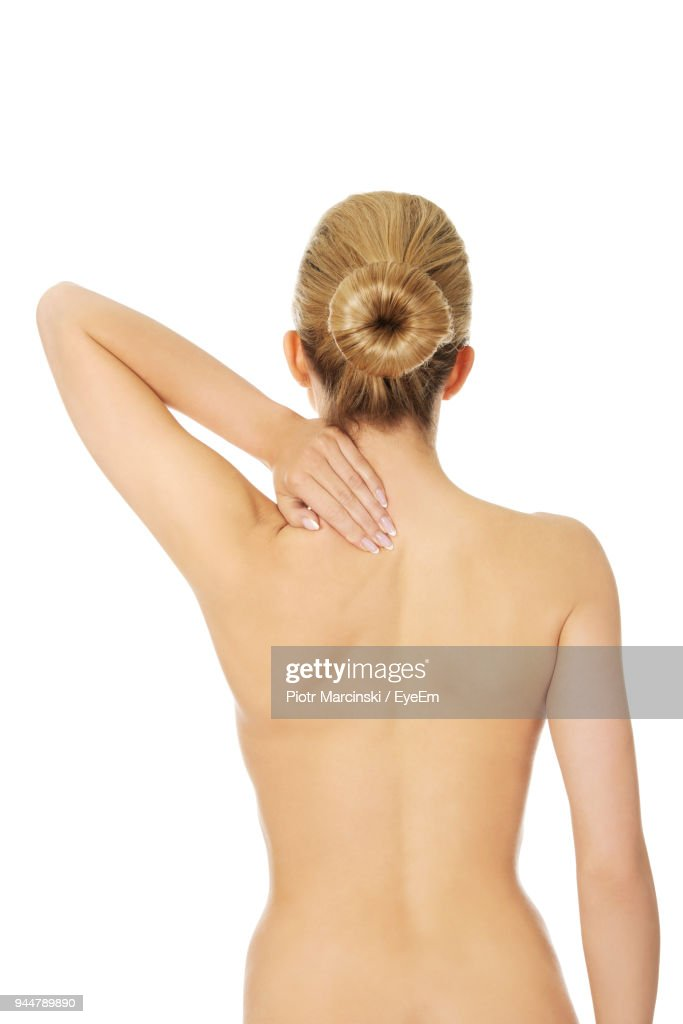Rear View Of Shirtless Woman Against White Background : Stock Photo
