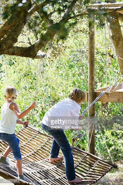 Boy And Girl Tied Up In Rope Stock Photos And Pictures