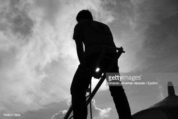 rear view of silhouette man against sky - special:whatlinkshere/file:lucerne_circle,_orlando,_fl.jpg stock pictures, royalty-free photos & images