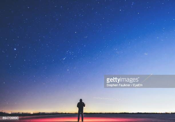 Rear View Of Silhouette Man Standing Against Clear Sky