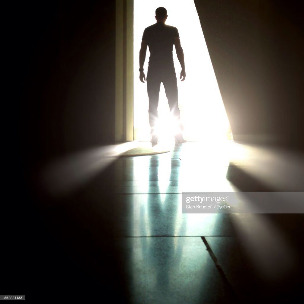 Rear View Of Silhouette Man Standing Against Light At Doorway & Doorway Stock Photos and Pictures   Getty Images pezcame.com