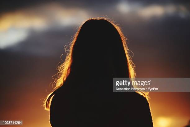 rear view of silhouette woman against sky during sunset - back lit stock pictures, royalty-free photos & images