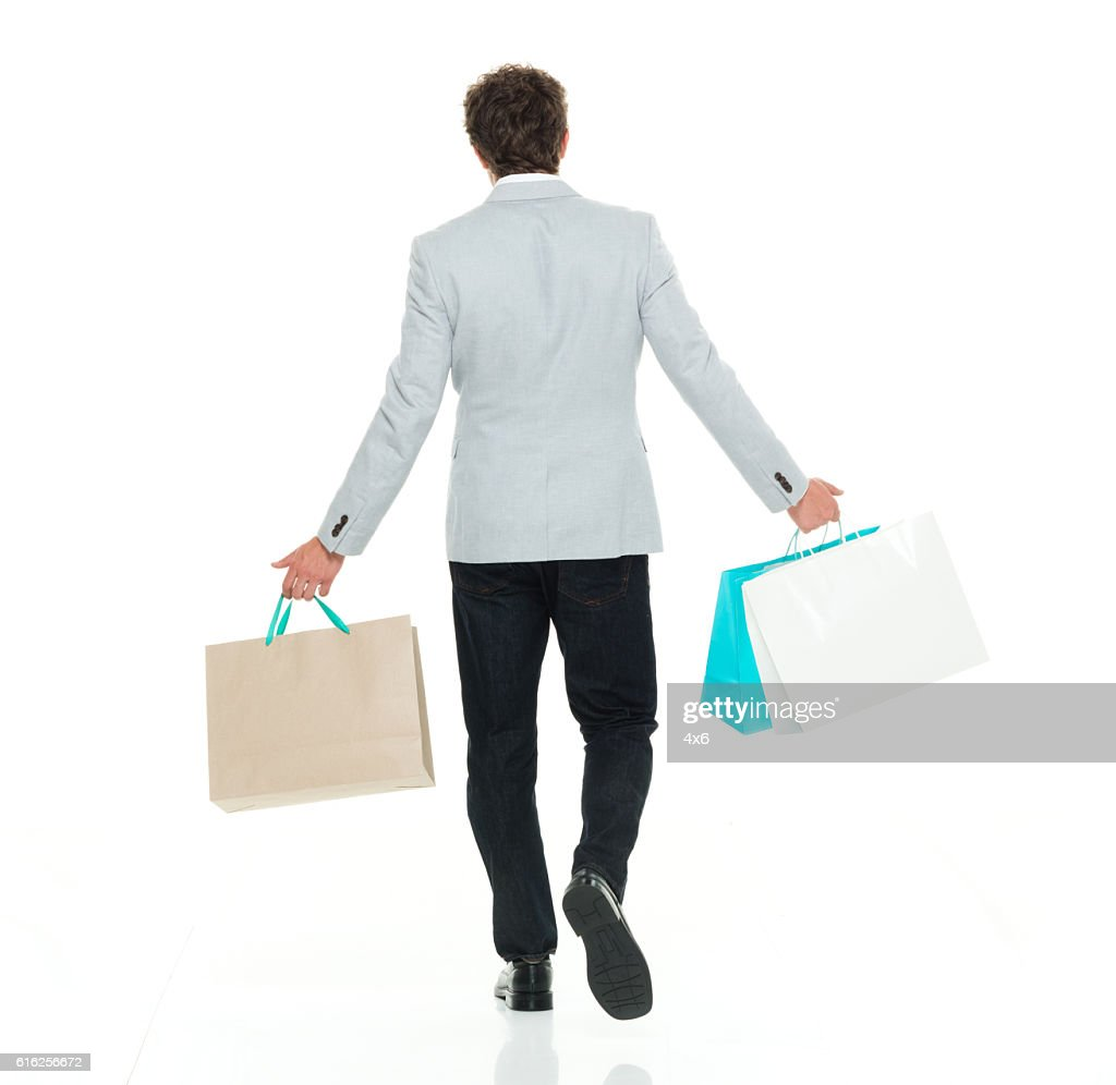 Rear view of smart casual man looking away : Stock Photo