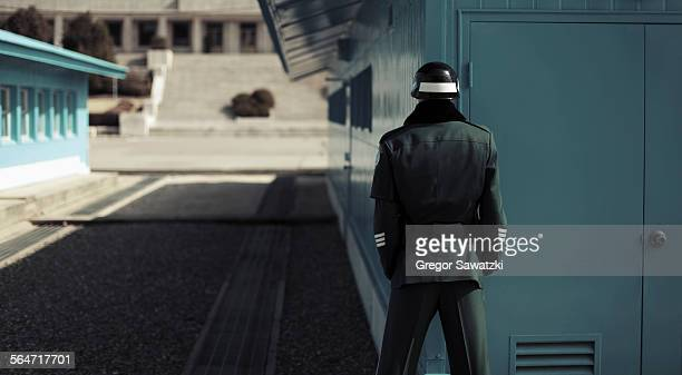 rear view of soldier standing at korean demilitarized zone, south korea - korea stock pictures, royalty-free photos & images