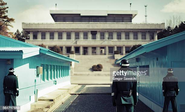 rear view of soldiers standing at korean demilitarized zone, south korea - south korea stock pictures, royalty-free photos & images