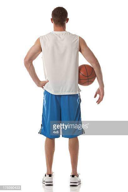 Rear view of sportsman holding a basketball