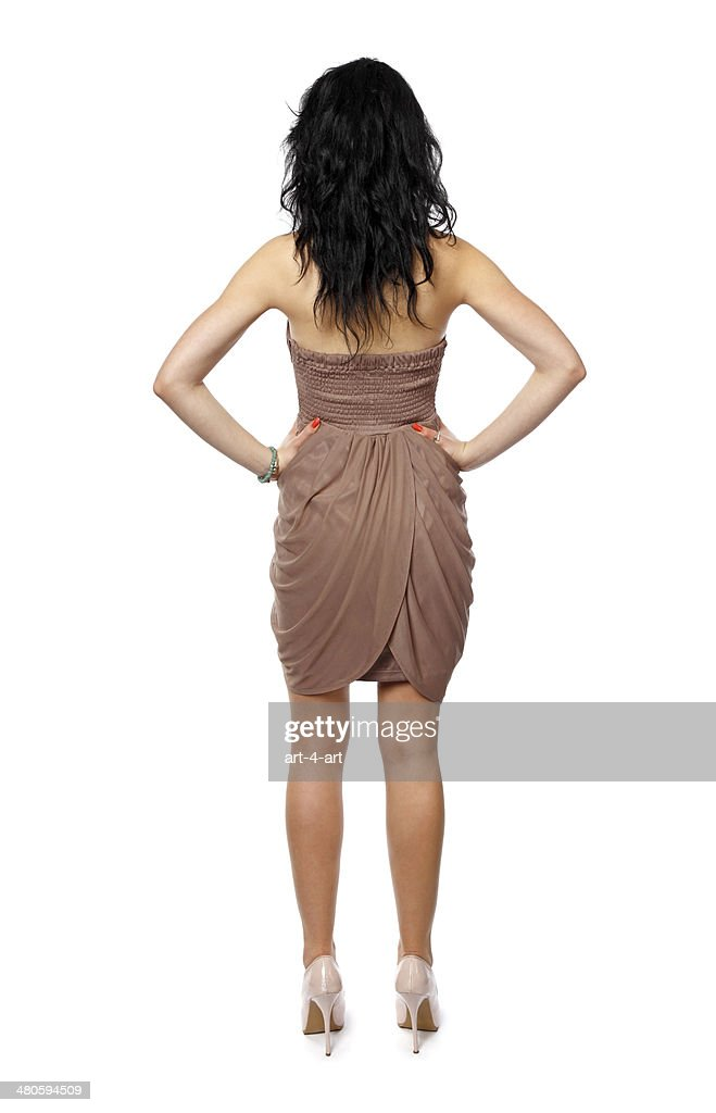 Rear view of standing brunette women : Stock Photo