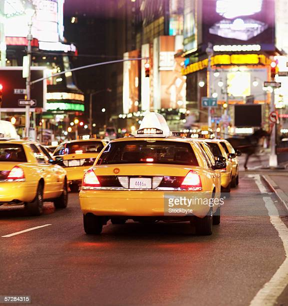Rear view of taxis driving through times square in new York