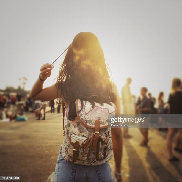 rear view of teenage girl walking on footpath during sunset - one teenage girl only stock pictures, royalty-free photos & images