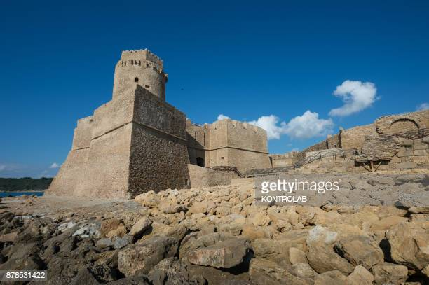 A rear view of the Aragonese Castle of Le Castella in Calabria southern Italy An important tourist destination of Calabria visited every year by...