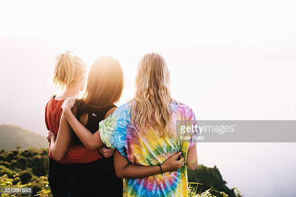 Rear view of three female friends looking out over Lake Atitlan, Guatemala