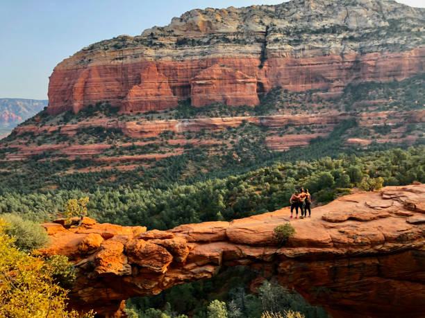 Rear view of three female hikers on Devil's Bridge