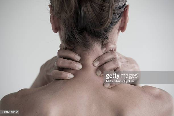 Rear View Of Tired Woman Holding Neck