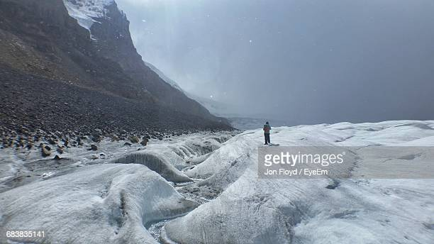 rear view of tourist on snow covered landscape - columbia icefield stock pictures, royalty-free photos & images