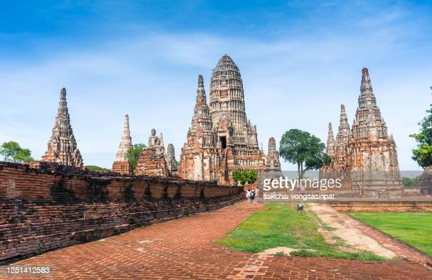 rear view of tourist walking at buddhist temple in the city of ayutthaya historical park in thailand, asia - ayuthaya province stock pictures, royalty-free photos & images