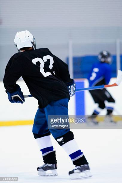rear view of two ice hockey players playing ice hockey - ice hockey glove stock pictures, royalty-free photos & images