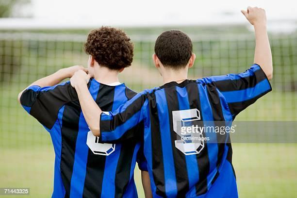 rear view of two soccer players - fotbollskläder bildbanksfoton och bilder