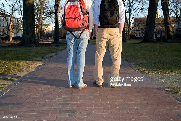 Rear view of two students outside of university