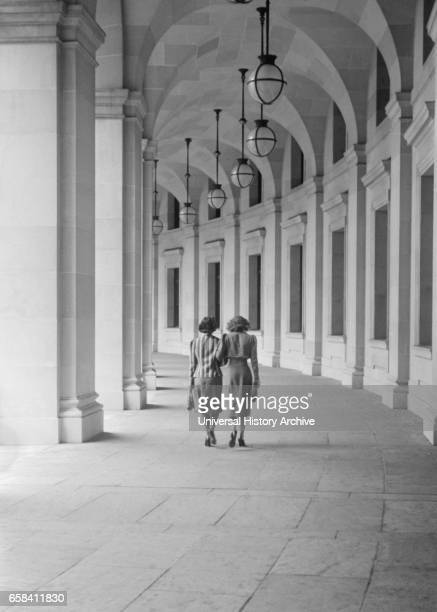 Rear View of Two Women Walking on Curved Walk Leading from Benjamin Franklin Post Office, 12th Street near Pennsylvania Avenue, Washington DC, USA,...