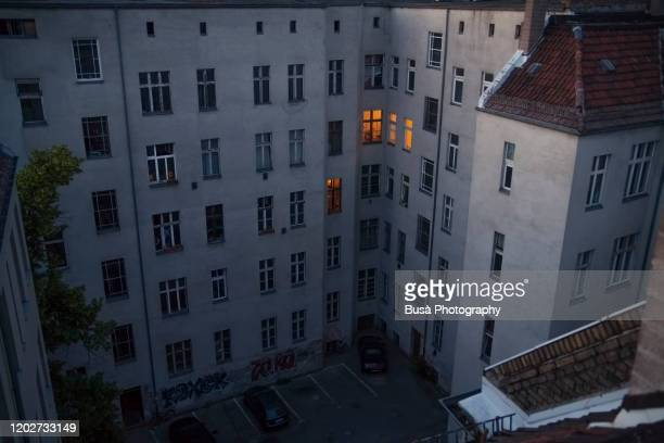 rear view of typical residential buildings in berlin, germany, at twilight - courtyard - fotografias e filmes do acervo