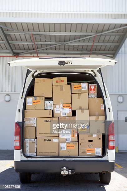 Rear view of van full of cardboard boxes