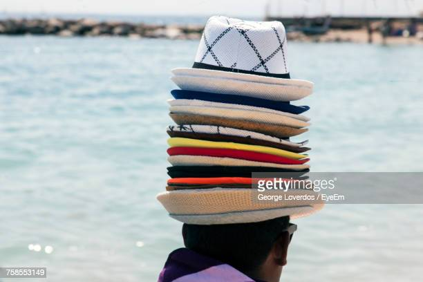 Rear View Of Vendor Wearing Hats