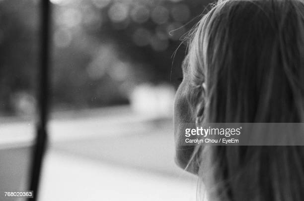 rear view of woman against blurred background - carolyn chou stock pictures, royalty-free photos & images