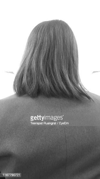 rear view of woman against clear sky - 人の背中 ストックフォトと画像