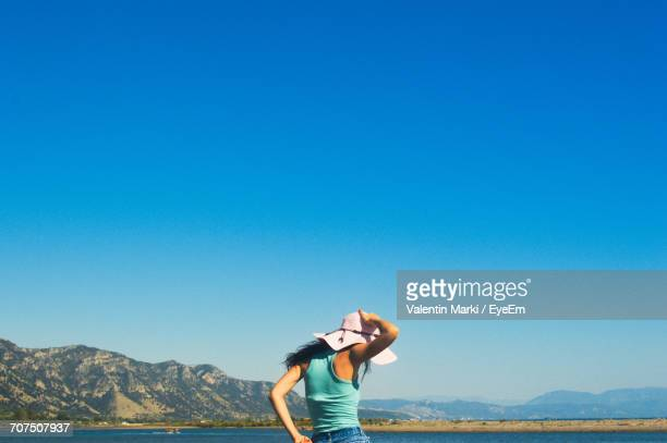 Rear View Of Woman Against Clear Sky