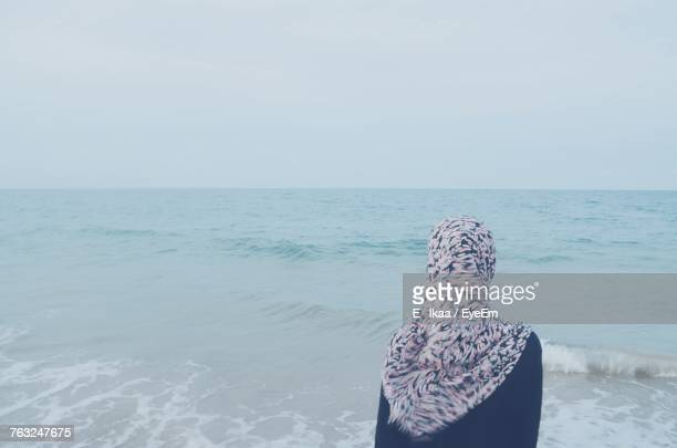 Rear View Of Woman Against Sea