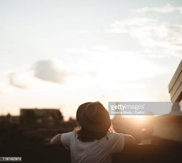 rear view of woman against sky during sunset - one young woman only stock pictures, royalty-free photos & images