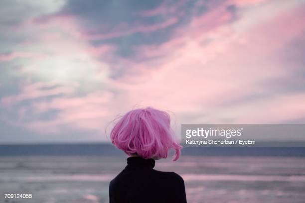 rear view of woman against sky - pink hair stock pictures, royalty-free photos & images
