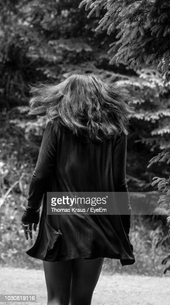 Rear View Of Woman Against Tree
