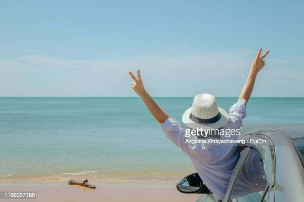 rear view of woman at beach against sky - one mature woman only stock pictures, royalty-free photos & images
