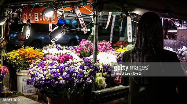 Rear View Of Woman At Flower Stall
