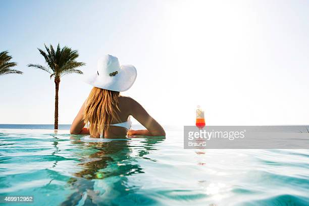 Rear view of woman at the swimming pool.