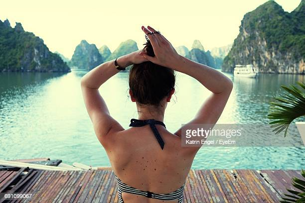 Rear View Of Woman By Beach