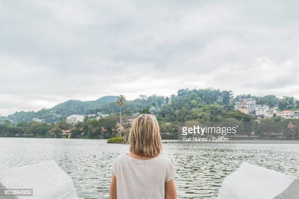 rear view of woman by river - kandy kandy district sri lanka stock pictures, royalty-free photos & images
