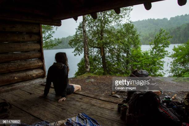 Rear view of woman camping in forest