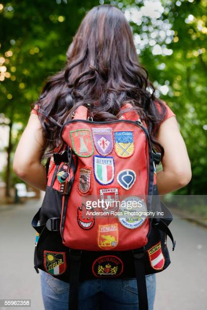 rear view of woman carrying backpack - satchel bag stock photos and pictures