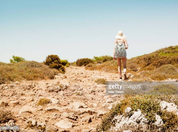 rear view of woman carrying beach bag, menorca, spain - woman carrying tote bag stock photos and pictures