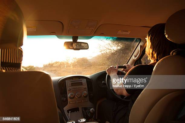 Rear View Of Woman Driving Car