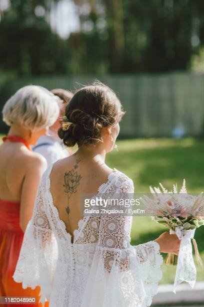rear view of woman during wedding - bridesmaid stock pictures, royalty-free photos & images