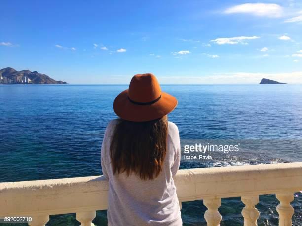 rear view of woman enjoying the sea view - alicante fotografías e imágenes de stock