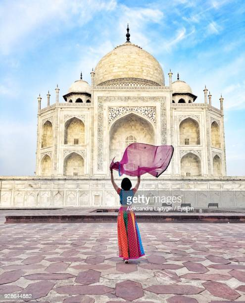 rear view of woman holding dupatta against taj mahal - dupatta stock pictures, royalty-free photos & images