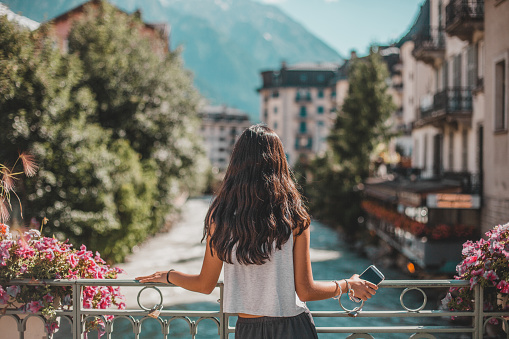 rear view of woman in Chamonix-Mont Blanc village and French alps - gettyimageskorea