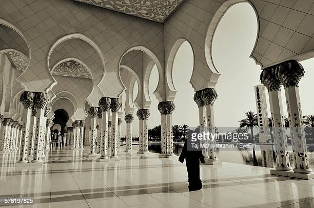 Rear View Of Woman In Colonnade At Sheikh Zayed Grand Mosque